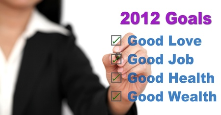 achievable: Asian business woman listing her goals in 2012 Stock Photo