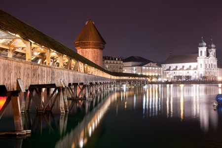Famous wooden Chapel bridge foot walkway in Lucerne, Switzerland photo