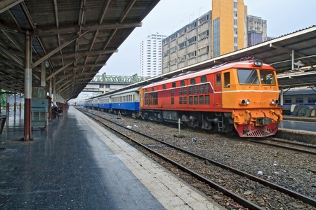 diesel train: Perspective of Red orange train, Diesel locomotive, on Bangkok railway station platform Thailand Editorial