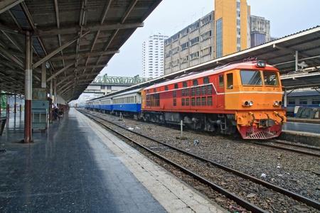 Perspective of Red orange train, Diesel locomotive, on Bangkok railway station platform Thailand Editorial