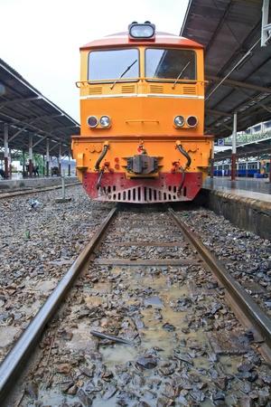 Deisel Engine of Red orange train, Diesel locomotive, on Bangkok railway station platform Thailand