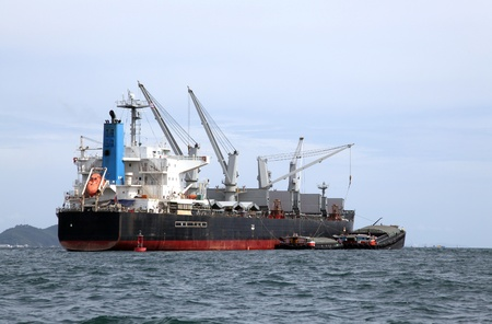 tanker ship: cargo liner freight Ship with containers and tug ship