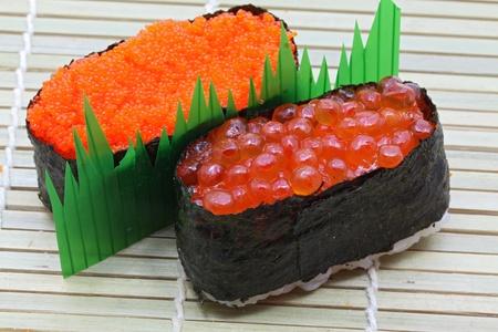 maki sushi: closeup of salmon egg and red caviar sushi