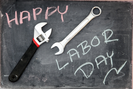 Happy Labor Day on blackboard with wrench Stock Photo - 10340151