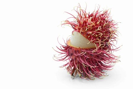 rambutan: macro shot of peel tropical rambutan fruit on white background with copy space for your text