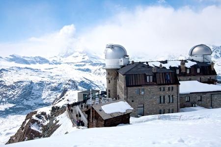 chocolate peak: The Gornergrat Observatory and Matterhorn peak, Zermatt Switzerland Editorial