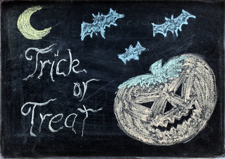 halloween drawing on chalkboard or blackboard with trick or treat photo