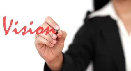 asian business woman hand writing vision word photo