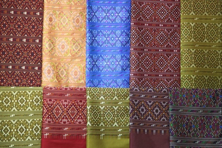 pieces of colorful praewa silk fabric cloth using as background photo