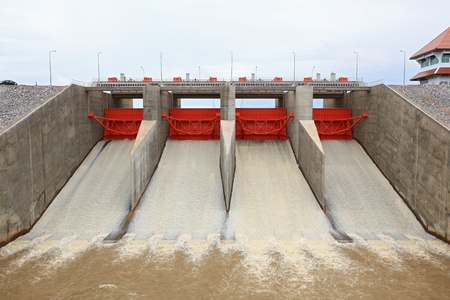 thai dam: close up of Water pouring through the water gates at dam Stock Photo
