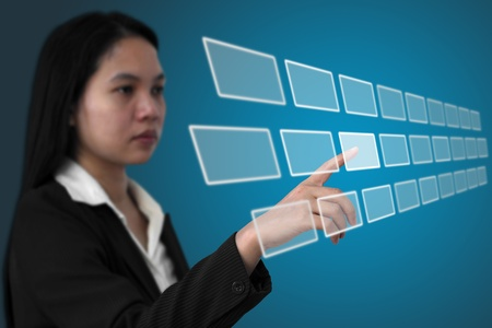 hightech: asian business woman touch on touchscreen interface (Selective focus on finger)