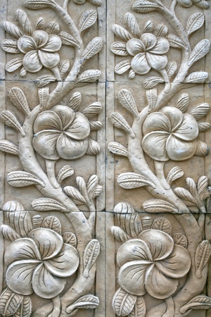 symbolism: flower shape stone carving on wall in bali style