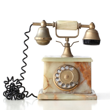 ancient telephone: isolated  vintage telephone made of marble with its reflection
