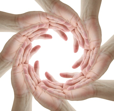 teamwork Conceptual symbol of human hands making a circle on white background with a copy space in the middle photo
