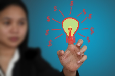 business woman make money from new idea concept (Selective focus on finger) Stock Photo - 10589841