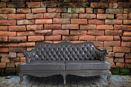 wall covering: black genuine leather classical style sofa in vintage room Stock Photo