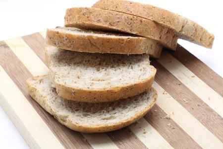 thresh grain: closeup of Fresh bread on wooden board