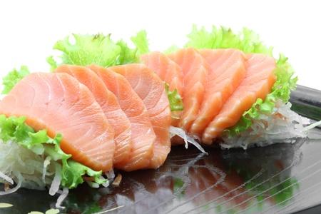 pink salmon: appetizer salmon sashimi on black dish with reflection