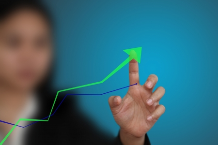 increase sales: business hand point at up trend graph