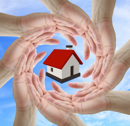 A diverse business team holding home for insurance concept Stock Photo - 10589895