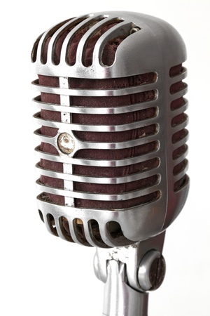 announcer: extreme closeup of vintage microphone isolated on white
