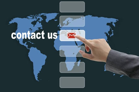male business hand pushing on contact us button with world map background Stock Photo - 10649419