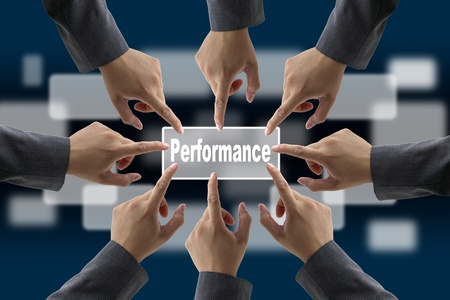 A diverse business team with hands together push Performance button photo