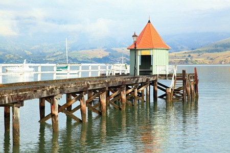 new way: motor boat jetty pier building on lake at Akaroa New Zealand Editorial