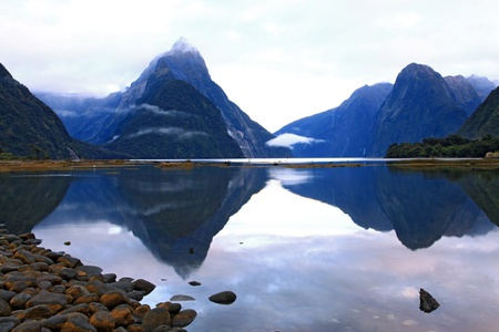 reflection of high mountain glacier at milford sound, New Zealand photo