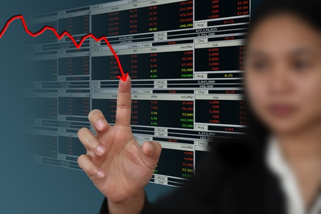Business woman point to falling graph of stock market photo