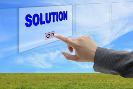 asian business man hand push on Solution button on touch screen panel for business concept Stock Photo - 10714512