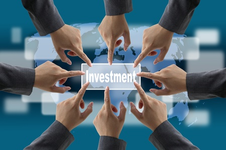 global investing: A diverse business teamwork do World technology Investment Stock Photo