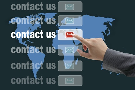male business hand pushing on contact us button with world map background Stock Photo - 10714523