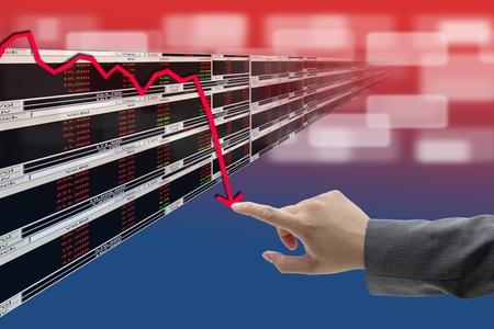 regression: hand push on decrease graph of Stock market Stock Photo