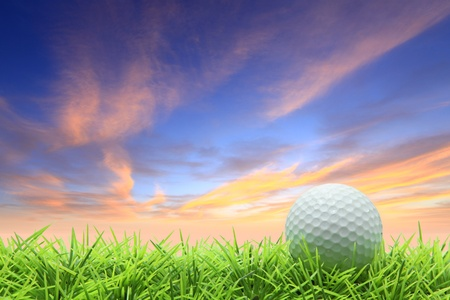 isolated golf ball on green grass over beautiful sky photo