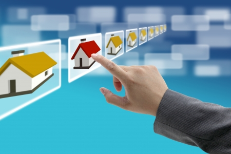 real estate house: man hand Finding new property in real estate market with electronic commerce concept