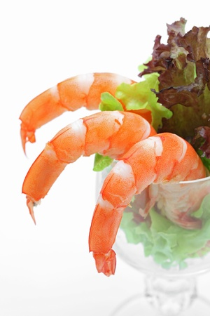 Shrimp cocktail in a martini glass with lettuce, closeup  photo