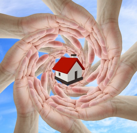 A diverse business team holding home for insurance concept Stock Photo - 10768319