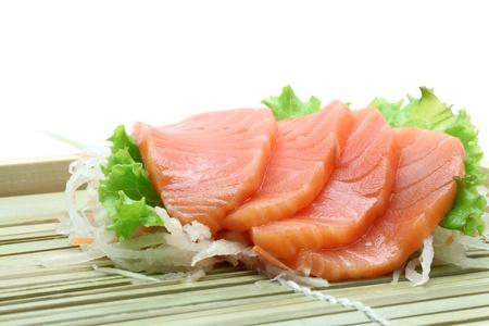 pink salmon: Fresh salmon sashimi salad on bamboo dish Stock Photo
