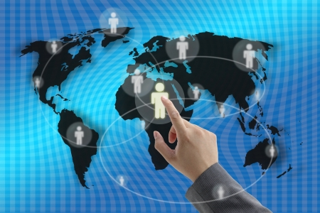 Businessman hand touching virtual screen interface with world recruitment background photo