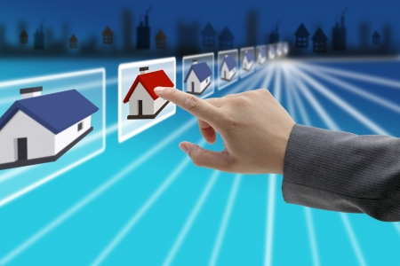 man hand Finding new property in real estate market with electronic commerce concept photo