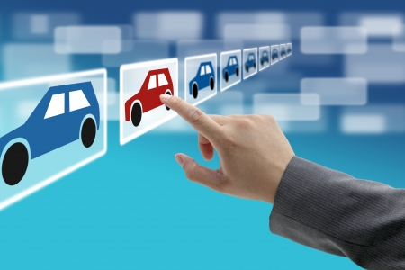 automobile dealership: man hand select new car from electronic showroom for e-commerce concept
