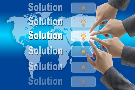 company vision: male business hand pushing on solution button with world map background