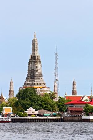 landscape of Wat Arun or Temple of dawn located at Chaophraya river in Bangkok Thailand, vertical photo