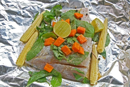 Preparation of Raw White sea bass with herb,corn carrot sweet basil and lime in Traditional Thai Style photo