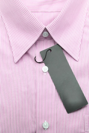 Close up view of a generic line pattern red business shirt with a blank label photo