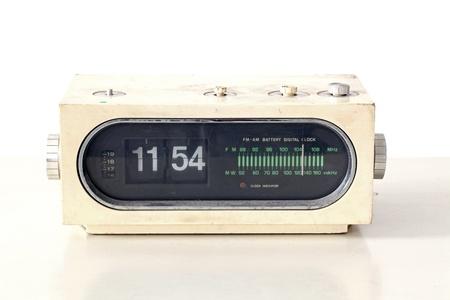 vintage clock radio set on old table photo
