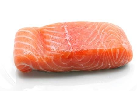 fillet of fresh raw salmon seafood ingredient on dish photo