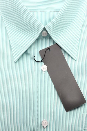 Close up view of a generic line pattern green business shirt with a blank label photo