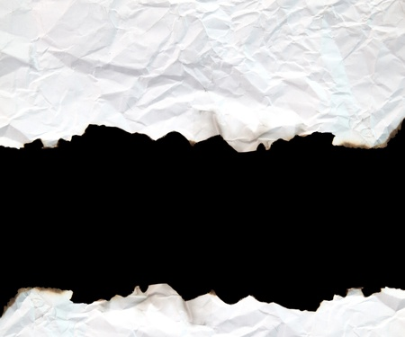 burnt edge paper with space for text on black background photo